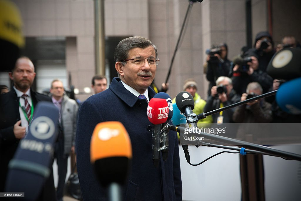 Turkey's Prime Minister, <a gi-track='captionPersonalityLinkClicked' href=/galleries/search?phrase=Ahmet+Davutoglu&family=editorial&specificpeople=4940018 ng-click='$event.stopPropagation()'>Ahmet Davutoglu</a>, speaks to the media as he arrives at the Council of the European Union on the second day of an EU summit, on March 18, 2016 in Brussels, Belgium. EU leaders have gathered for a two-day summit to discuss a number of issues including the ongoing migrant crisis.