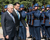 Turkey's Prime Minister Binali Yildirim and Turkish Republic of Northern Cyprus Prime Minister Huseyin Ozgurgun inspect an honor guard during an...