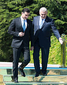 Turkey's Prime Minister Binali Yildirim gestures alongside Turkish Republic of Northern Cyprus Prime Minister Huseyin Ozgurgun during an official...