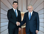 Turkey's Prime Minister Binali Yildirim shakes hands with Turkish Republic of Northern Cyprus Prime Minister Huseyin Ozgurgun during an official...