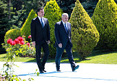 Turkey's Prime Minister Binali Yildirim walks with Turkish Republic of Northern Cyprus Prime Minister Huseyin Ozgurgun during an official welcoming...