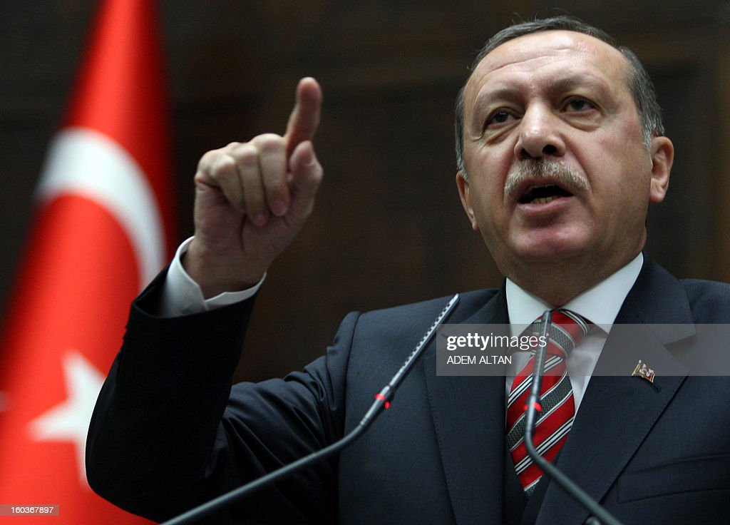 Turkey's Prime Minister Recep Tayyip Erdogan addresses members of parliament in Ankara on January 30, 2013.