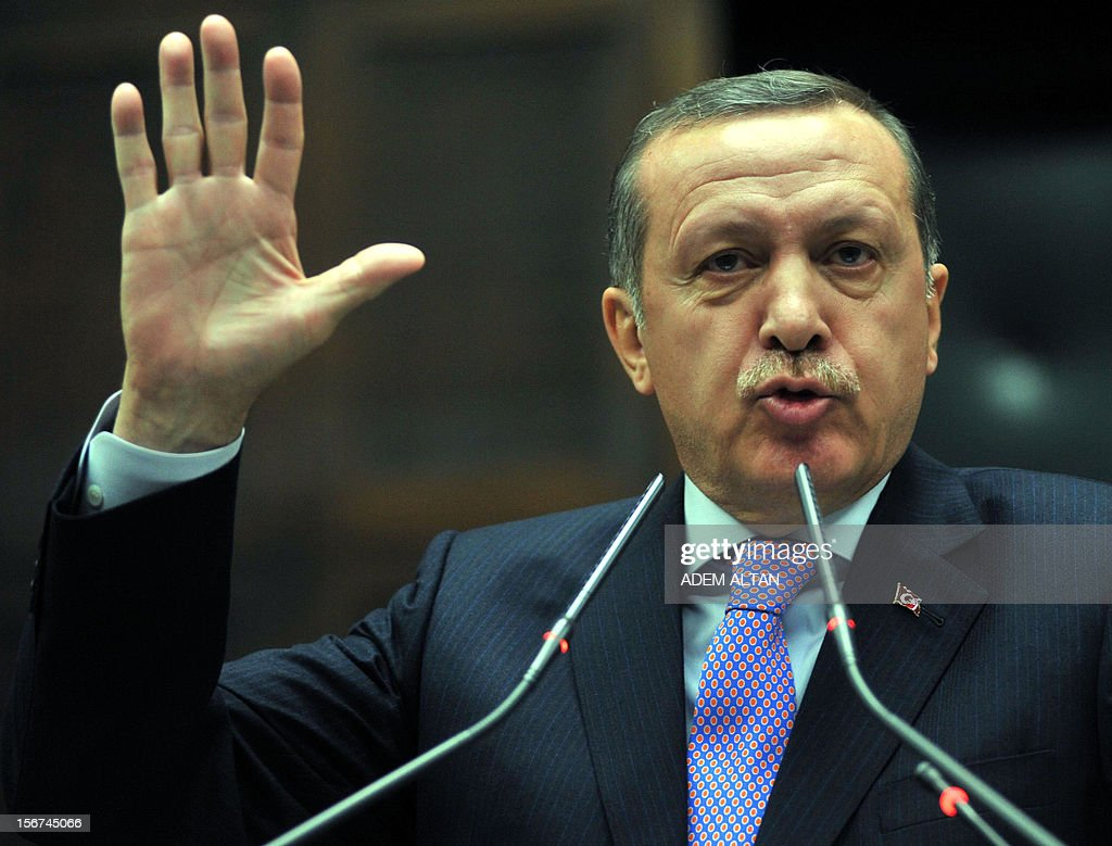 Turkey's Prime Minister Recep Tayyip Erdogan addresses members of the parliament in Ankara on November 20, 2012. Erdogan said he was not opposed to talks between the state and the jailed Kurdish leader to bring an end to the insurgency, media reported Tuesday. AFP PHOTO / ADEM ALTAN