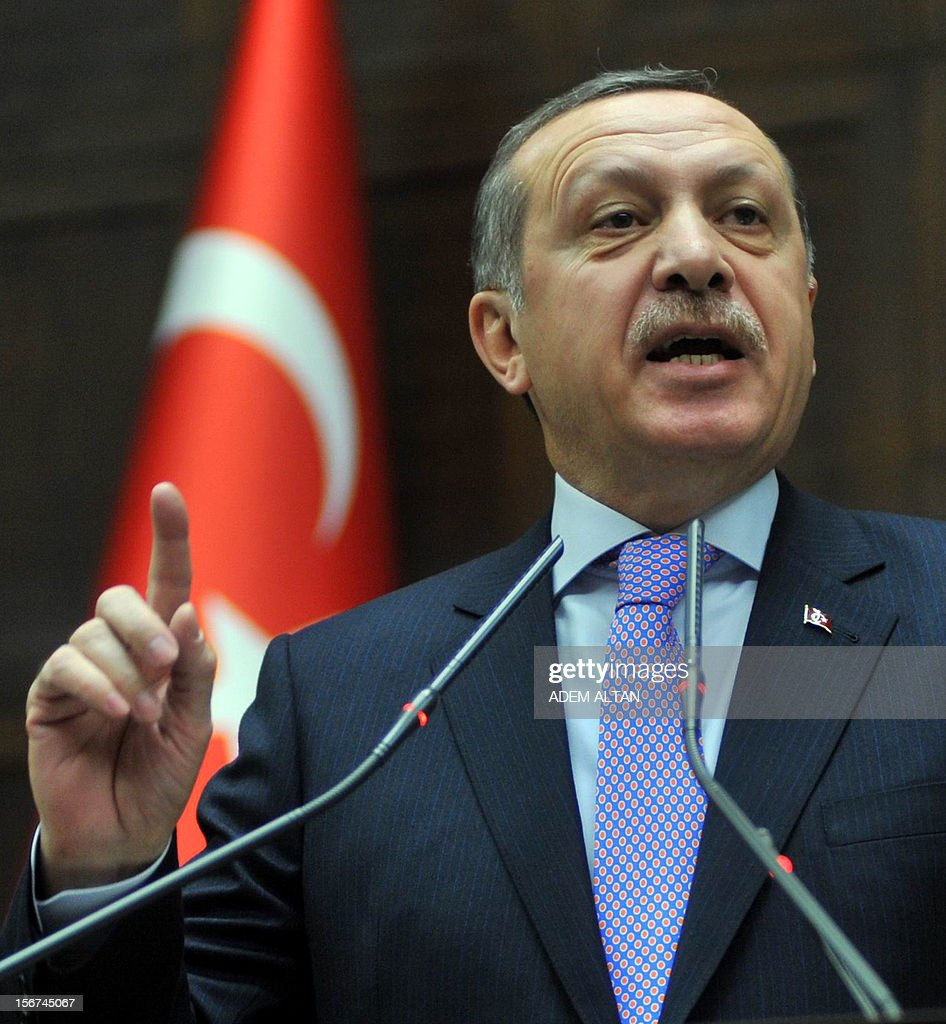 Turkey's Prime Minister Recep Tayyip Erdogan addresses members of the parliament in Ankara on November 20, 2012. Erdogan said he was not opposed to talks between the state and the jailed Kurdish leader to bring an end to the insurgency, media reported Tuesday.