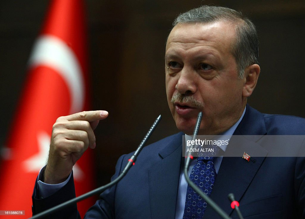 Turkey's Prime Minister Recep Tayyip Erdogan addresses MPs at the parliament in Ankara, on February 12, 2013.