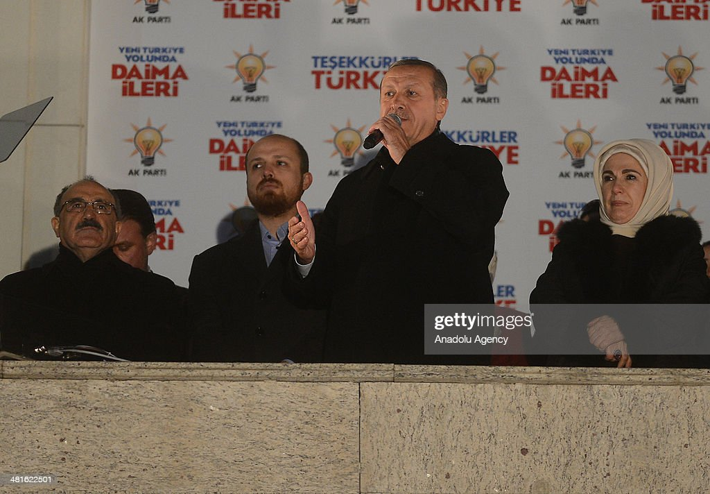Turkey's Prime Minister Recep Tayyip Erdogan (2nd R) addresses to the crowd from the balcony of Justice and Development Party headquarters in Ankara, Turkey on March 31, 2014. Erdogan's son Bilal Erdogan (2nd L), his wife Emine Erdogan (R) and deputy Prime Minister Besir Atalay (L) accompany him during his speech. According to early unofficial results, the ruling Justice and Development Party received 47 percent of the votes, with nearly 43 percent of ballot boxes having been opened across the country.