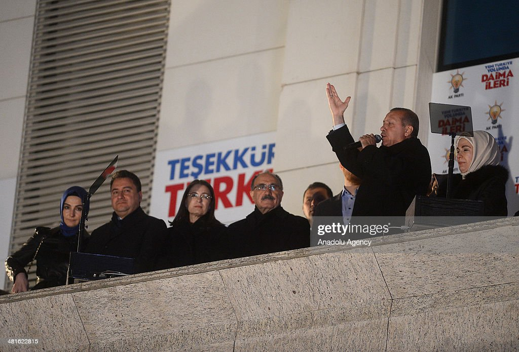 Turkey's Prime Minister Recep Tayyip Erdogan (2nd R) addresses to the crowd from the balcony of Justice and Development Party headquarters in Ankara, Turkey on March 31, 2014. Erdogan's wife Emine Erdogan (R) and deputy Prime Minister Besir Atalay (4th L), Family and Social Policies Minister Aysenur Islam (3rd L) and Deputy Prime Minister Ali Babacan (2nd L) accompany Turkish PM during his speech. According to early unofficial results, the ruling Justice and Development Party received 47 percent of the votes, with nearly 43 percent of ballot boxes having been opened across the country.