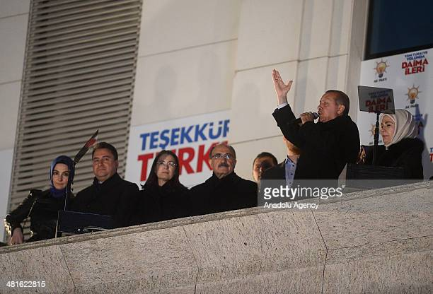 Turkey's Prime Minister Recep Tayyip Erdogan addresses to the crowd from the balcony of Justice and Development Party headquarters in Ankara Turkey...