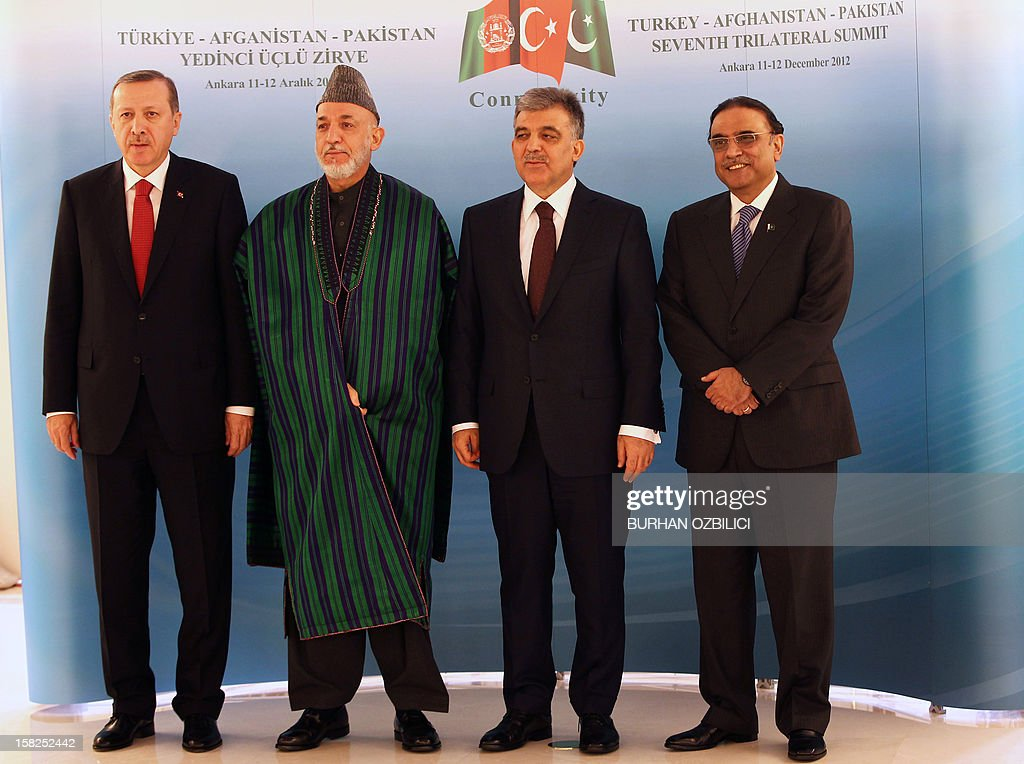 Turkey's Prime Minister Recep Tayyip Erdogan, Afghan President Hamid Karzai, Turkish President Abdullah Gul and Pakistani President Asif Ali Zardari pose for a family photo after their meeting in Ankara on December 12, 2012. AFP PHOTO / POOL / Burhan Ozbilici