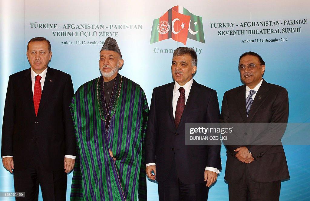 Turkey's Prime Minister Recep Tayyip Erdogan, Afghan President Hamid Karzai, Turkish President Abdullah Gul and Pakistani President Asif Ali Zardari pose for a family photo after their meeting in Ankara on December 12, 2012. AFP PHOTO / POOL / Burhan Ozbilici
