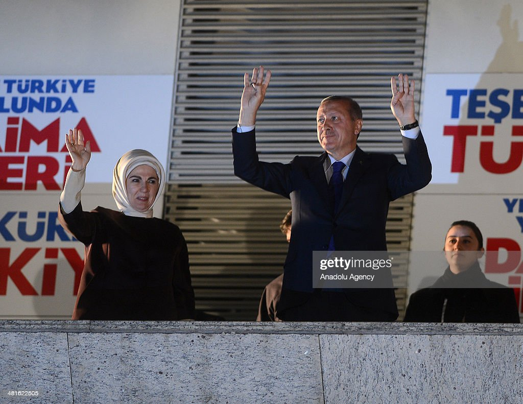Turkey's Prime Minister Recep Tayyip Erdogan (R) and his wife Emine Erdogan (L) greet crowd from the balcony of Justice and Development Party headquarters in Ankara, Turkey on March 31, 2014. According to early unofficial results, the ruling Justice and Development Party received 47 percent of the votes, with nearly 43 percent of ballot boxes having been opened across the country.