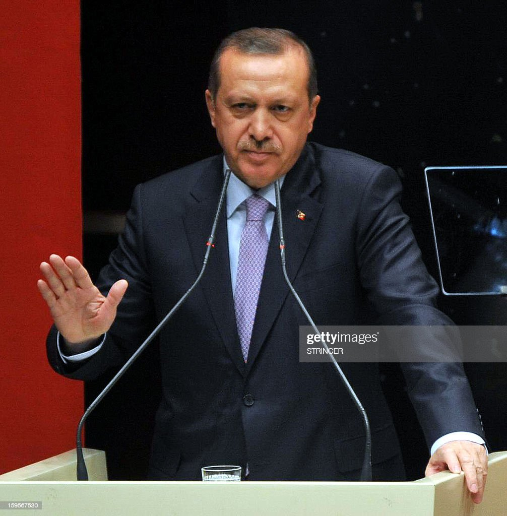 Turkey's Prime Minister Recep Tayyip Erdogan gestures as he speaks during a meeting at his ruling Justice and Development Party (AKP) party headquarters in Ankara on January 16, 2013. Turkey has sought information from France over the killing of three women Kurdish activists in Paris, a foreign ministry spokesman said January 15, 2013.