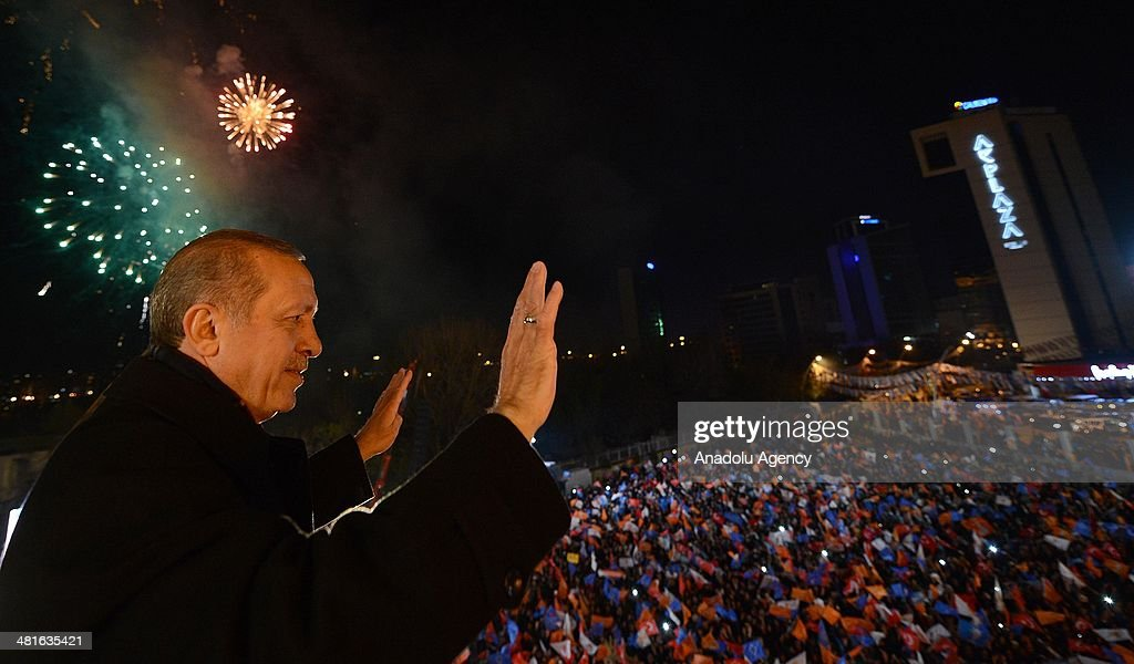 Turkey's Prime Minister Recep Tayyip Erdogan greets supporters from the balcony of Justice and Development Party headquarters in Ankara, Turkey on March 31, 2014. According to early unofficial results, the ruling Justice and Development Party received 47 percent of the votes, with nearly 43 percent of ballot boxes having been opened across the country.