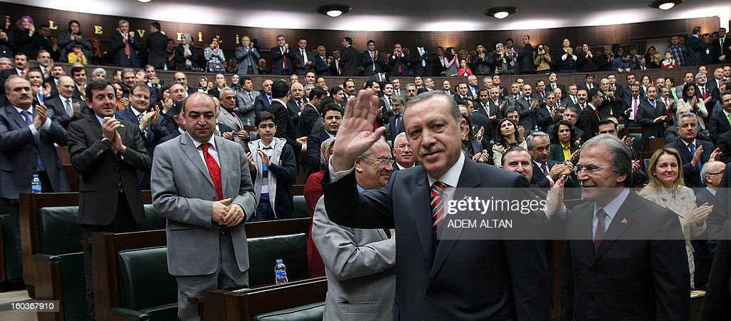 Turkey's Prime Minister Recep Tayyip Erdogan (C) is applauded by members of parliament after an address in Ankara on January 30, 2013.