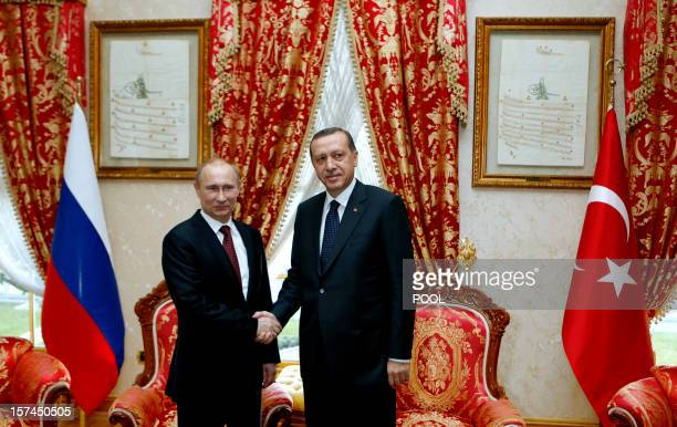 Turkey's Prime Minister Recep Tayyip Erdogan shakes hand with Russia's President Vladimir Putin in Istanbul on December 3 2012 Putin arrived in...