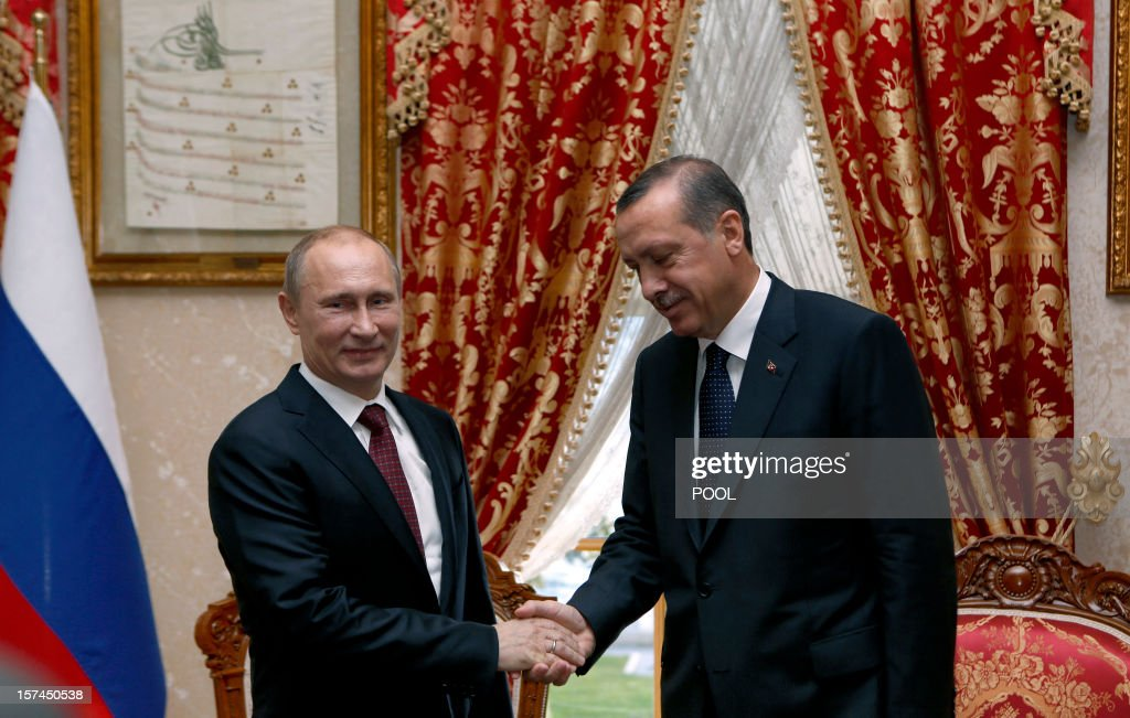 Turkey's Prime Minister Recep Tayyip Erdogan (R) shakes hands with Russia's President Vladimir Putin in Istanbul on December 3, 2012. Putin arrived in Istanbul on December 3 for a landmark visit due to focus on resolving differences with Turkey over the 20-month crisis in war-ravaged Syria. AFP PHOTO / POOL / TOLGA BOZOGLU