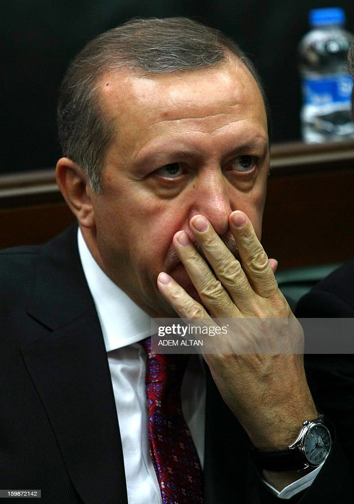 Turkey's Prime Minister Recep Tayyip Erdogan sits in parliament in Ankara on January 22, 2013. Turkish Prime Minister Recep Tayyip Erdogan said Tuesday his government was adamant to settle the three-decade Kurdish conflict including guaranteeing the safe withdrawal of the rebel group from its territory.