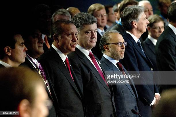 Turkey's Prime Minister Recep Tayyip Erdogan Ukrainian President Petro Poroshenko and UAE's Minister of State for Foreign Affairs Anwar Mohammed...
