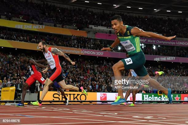 TOPSHOT Turkey's Ramil Guliyev crosses the finishline ahead of South Africa's Wayde Van Niekerk and Trinidad and Tobago's Jereem Richards in the...