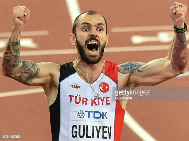 Turkey's Ramil Guliyev wins the final of the men's 200m athletics event at the 2017 IAAF World Championships at the London Stadium in London on...
