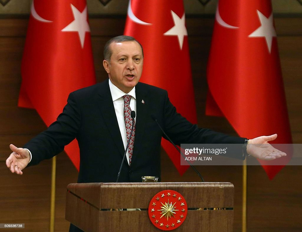 Turkey's Recep Tayyip Erdogan delivers a speech during the monthly Mukhtars meeting (local administrators) at the Presidential Complex in Ankara on February 10, 2016. Turkish President Recep Tayyip Erdogan on February 10 accused the United States of creating a 'pool of blood' in the region by failing to recognise the main Syrian Kurdish organisations as terror groups. / AFP / ADEM ALTAN