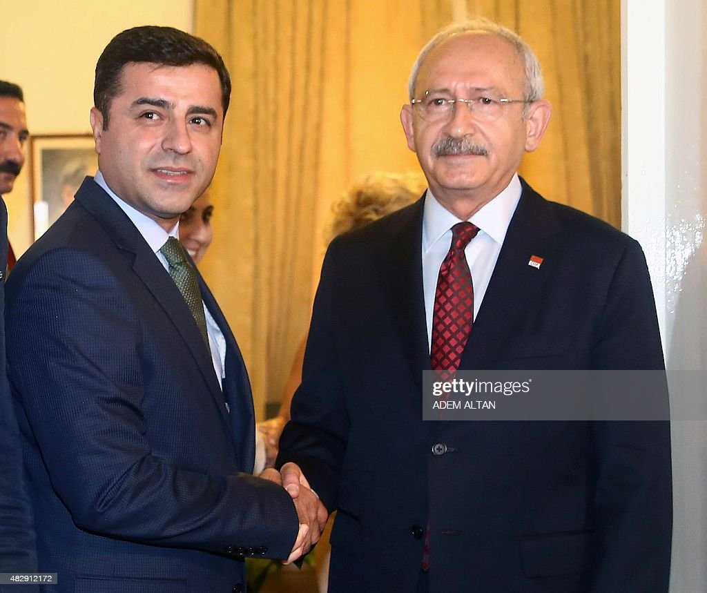 Turkey's Republican People's Party (CHP) leader <a gi-track='captionPersonalityLinkClicked' href=/galleries/search?phrase=Kemal+Kilicdaroglu&family=editorial&specificpeople=7129513 ng-click='$event.stopPropagation()'>Kemal Kilicdaroglu</a> (R) shakes hands with pro-Kurdish People's Democratic Party (HDP) co-leader Selahattin Demirtas (L) during a meeting in Ankara on August 4, 2015.