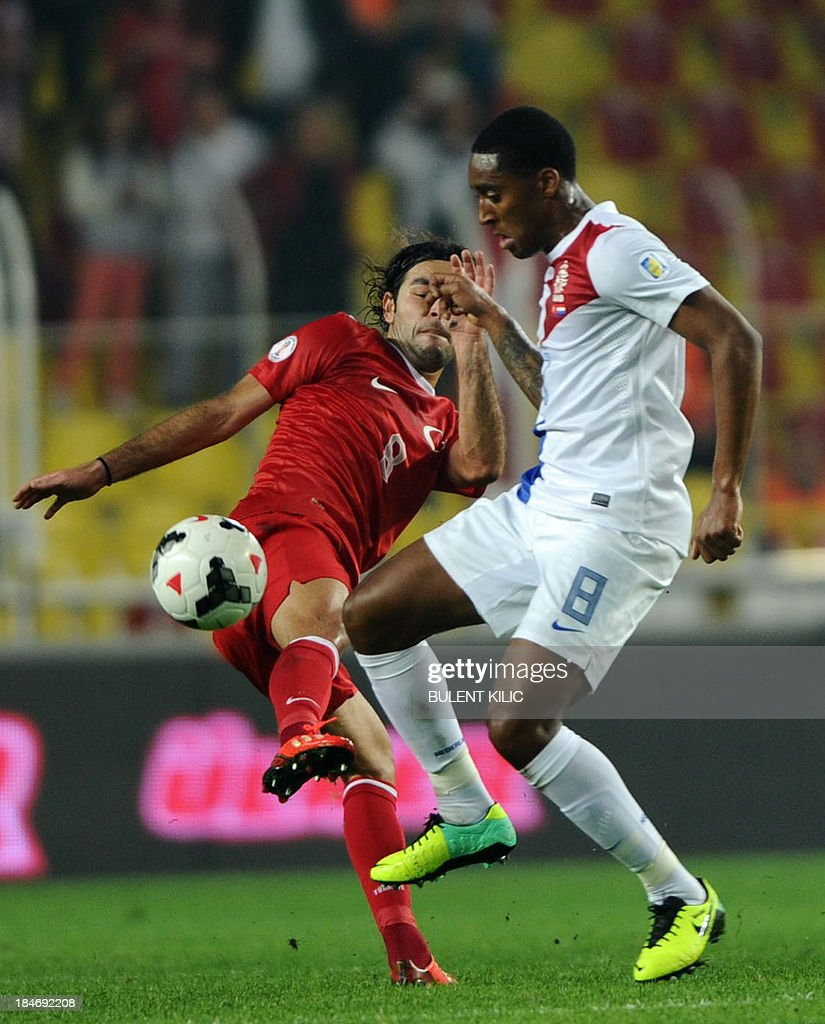 Turkey's Selcuk Inan (L) vies with Netherlands' s Leroy Fer (R) on October 15, 2013 during a FIFA 2014 World Cup qualifying football match Turkey vs Netherlands at the Sukru Saracoglu Stadium in Istanbul.