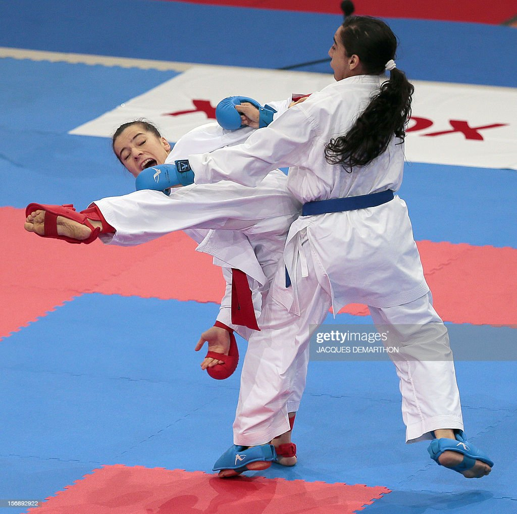Turkey's Serap Ozcelik (L) fights Morocco's Hiba Raouf to win a bronze medal in the Kumite -50kg category at the world karate championships in Paris on November 23, 2012. DEMARTHON