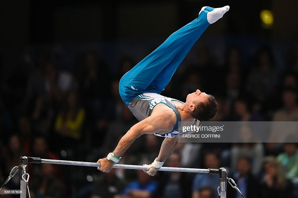 Turkeys Umit Samiloglu performs during the Mens Horizontal Bar competition of the European Artistic Gymnastics Championships 2016 in Bern, Switzerland on May 29, 2016. / AFP / FABRICE
