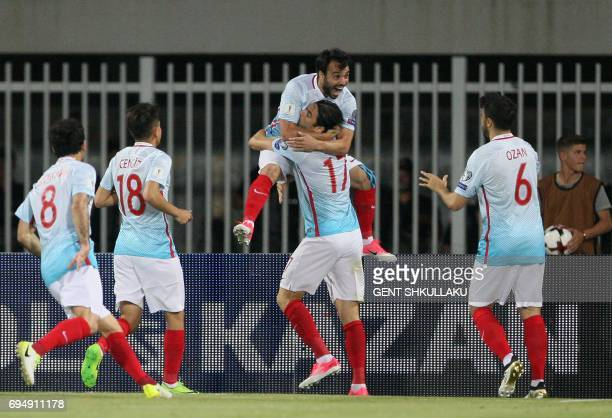 Turkey's Volkan Sen celebrates with teammates including Burak Yilmaz after scoring during the FIFA World Cup 2018 qualification football match...