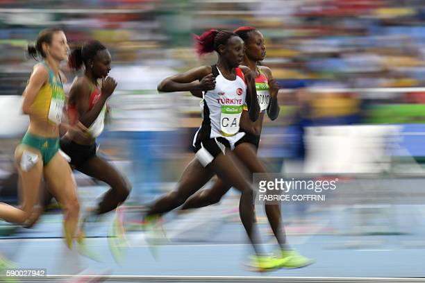 Turkey's Yasemin Can and Kenya's Mercy Cherono compete in the Women's 5000m Round 1 during the athletics event at the Rio 2016 Olympic Games at the...