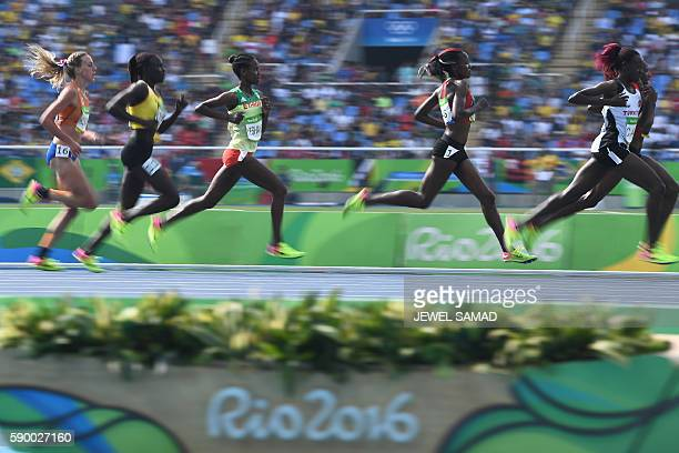 Turkey's Yasemin Can Kenya's Mercy Cherono and Ethiopia's Ababel Yeshaneh compete in the Women's 5000m Round 1 during the athletics event at the Rio...
