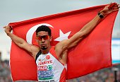 Turkey's Yasmani Copello Escobar celebrates as he crosses the finish line to win the men's 400 Hurdles final during the European Athletics...