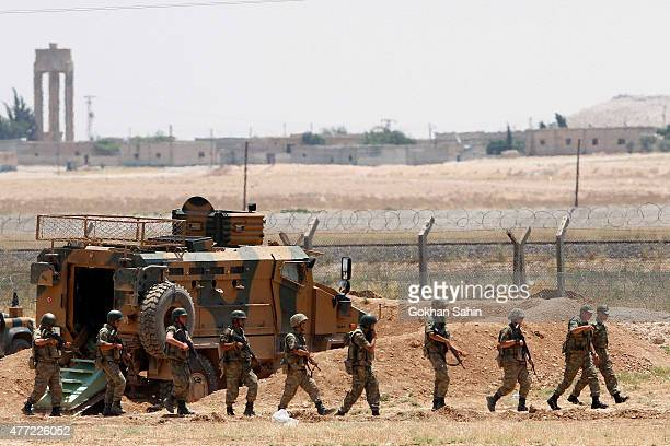 Turkis soldiers patrol the Syrian border in Akcakale on June 15 2015 in Sanliurfa province southeastern Turkey Thousands of Syrians cut through a...