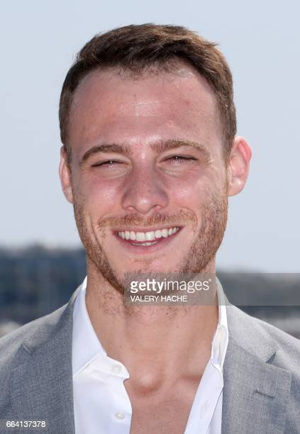 Turkish actor Kerem Bursin who stars in the series 'Heart of the city' poses during a photocall as part of the MIPTV event on April 3 2017 in Cannes...