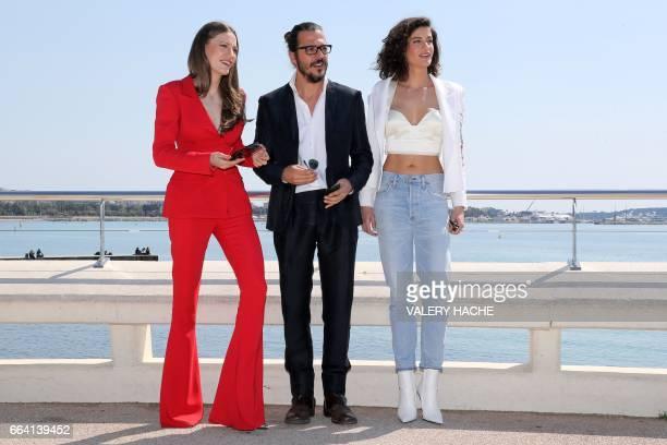 Turkish actors Seranay Sarikaya Mehmet Gunsur and Berrak Tuzunatac who star in the series 'Phi' pose during a photocall as part of the MIPTV event on...
