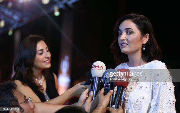 Turkish actress Fadik Sevin Atasoy answers the questions of press members ahead of the 54 International Antalya Film Festival in Antalya Turkey on...