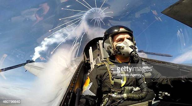 Turkish Air Forces Commander General Akin Ozturk flies with the Turkish Air Force Solo Turk display team to control choreography at the 141st Fleet...