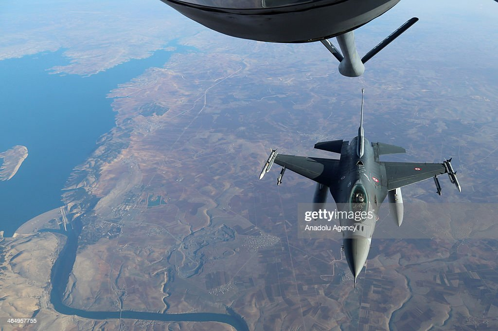 Turkish Air Force's F16 fighter jet gets ready to hook up a boom to receive midair refueling from a refueler tanker over Adana Turkey on January 5...