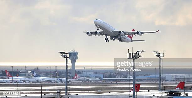 Turkish Airlines plane taking off at Ataturk Airport in Istanbul Turkey on December 30 after announcement of further flight cancellations due to...