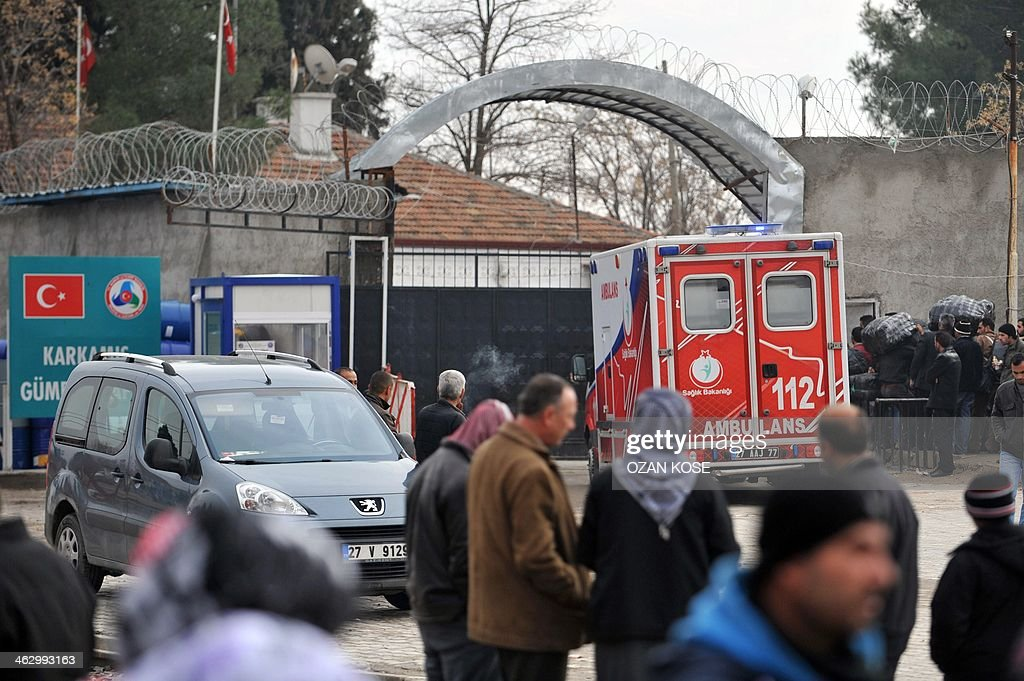 A Turkish ambulance crosses the Syrian border to bring back injured Syrian refugees on January 16 2014 in Karkamis near the town of Gaziantep south...