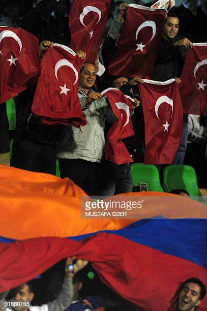 Turkish and Armenian fans wave their national flags at the Ataturk stadium in Bursa on October 14 2009 during the World Cup 2010 qualifying football...