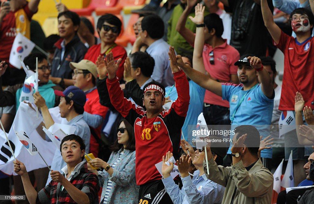 Turkish and Korea Republic spectators enjoy the atmosphere during the Group B match between Cuba and Korea Republic at Kadir Has Stadium on June 21, 2013 in Kayseri, Turkey.