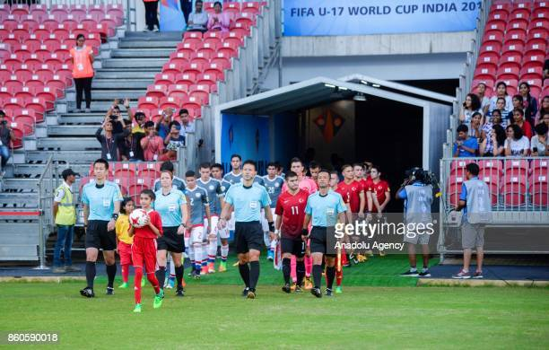 Turkish and Paraguayan footballers enter the field before the 2017 FIFA U17 World Cup football match between Turkey U17 and Paraguay U17 in Mumbai...