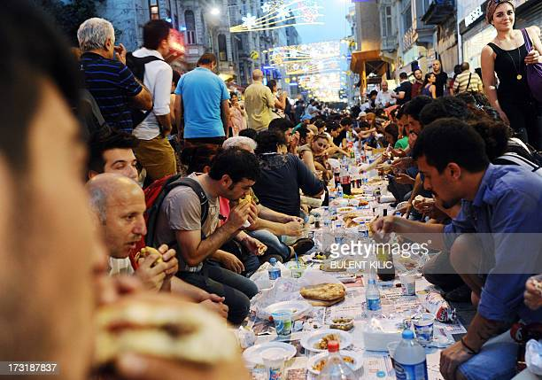 Turkish anti goverment protesters gather as they break their first day of fasting for the Muslim holy month of Ramadan on Istiklal street the main...