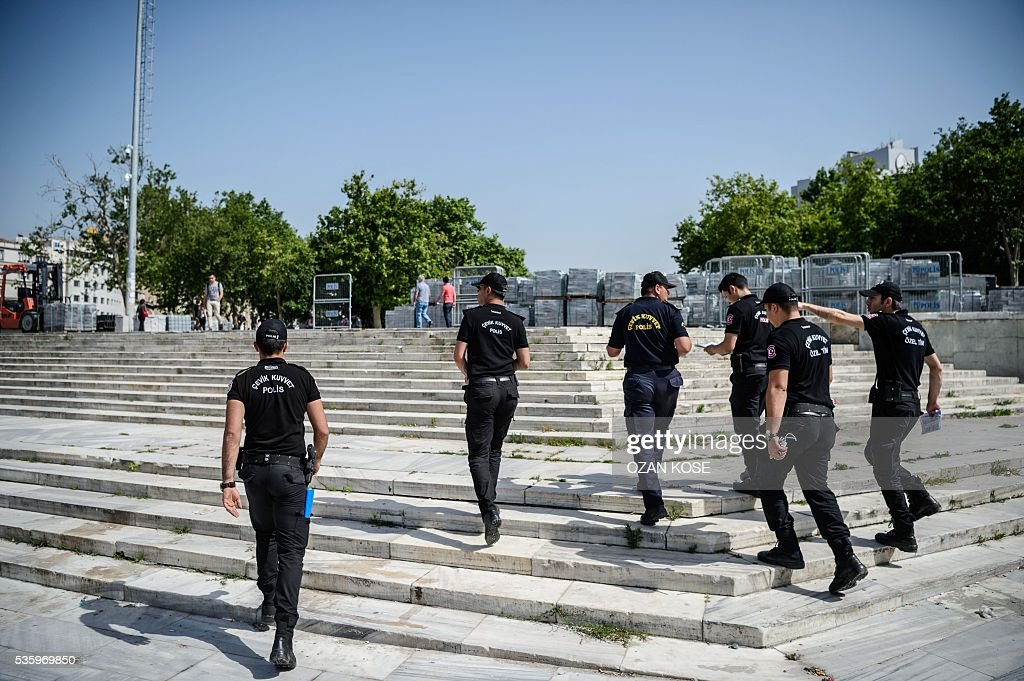 Turkish anti riot police officers patrol Gezi Park in Istanbul on May 31, 2016 on the third anniversary of Gezi Park protests. The Gezi Park protests which began in May 2013, were sparked by the heavy-handed eviction of demonstrators staging a sit-in protest against the redevelopment of the area and grew into often violent clashes with police as people demonstrated against much broader issues concerning perceived infringements of civil rights . / AFP / OZAN