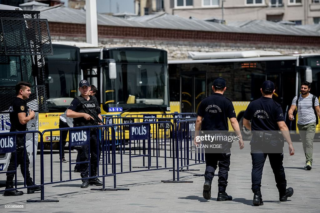 Turkish anti riot police officers patrol Taksim Square in Istanbul on May 31, 2016 on the third anniversary of Gezi Park protests. The Gezi Park protests which began in May 2013, were sparked by the heavy-handed eviction of demonstrators staging a sit-in protest against the redevelopment of the area and grew into often violent clashes with police as people demonstrated against much broader issues concerning perceived infringements of civil rights . / AFP / OZAN