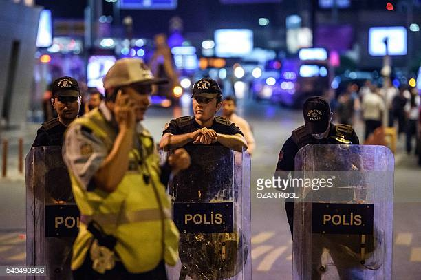 Turkish anti riot police officers secure the main enterance of the Ataturk airport in Istanbul June 28 2016 after two explosions followed by gunfire...