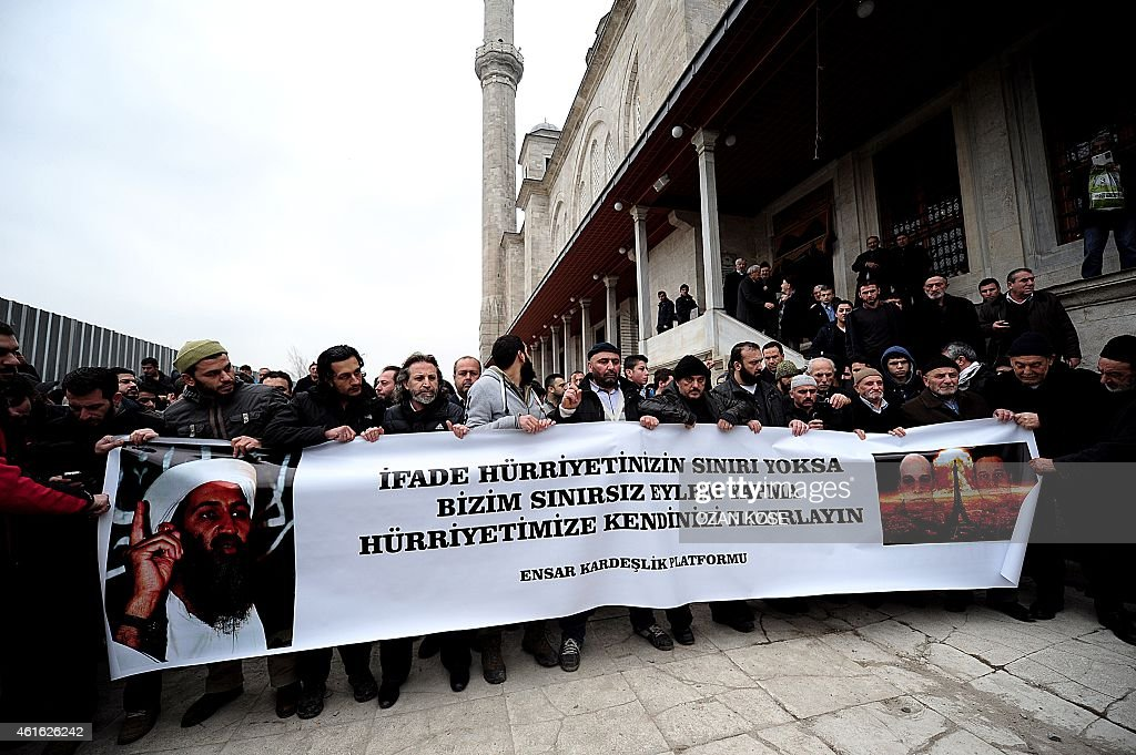 Turkish anti-Charlie Hebdo protesters hold a banner with pictures of <a gi-track='captionPersonalityLinkClicked' href=/galleries/search?phrase=Osama+Bin+Laden&family=editorial&specificpeople=120827 ng-click='$event.stopPropagation()'>Osama Bin Laden</a> (L) and Cherif and Said Kouachi (R), two Islamist gunmen who killed 12 people in an attack on Charlie Hebdo, and reading 'If there is no limit/border to the freedom of expression. Get ready to our protest rights without border' during a demonstration against the depiction of the Prophet Mohammed by the French satirical weekly and mourning two Islamist gunmen who killed 12 people in an attack on Charlie Hebdo, in Istanbul on January 16, 2015. About 50 Turkish islamists gathered after friday prayer at Fatih Mosque to protest after the magazine published this week a 'survivors' issue featuring an image of the Prophet Mohammed weeping, which sold out on January 14 before more copies of an eventual print run of five million hit newsstands in France.