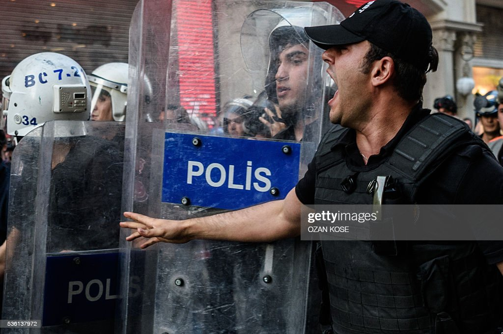 A Turkish anti-riot police officer reats on May 31, 2016 in Istanbul, during a demonstration commemorating the third anniversary of the start of the Gezi Park protests. The Gezi Park protests which began in May 2013, were sparked by the heavy-handed eviction of demonstrators staging a sit-in protest against the redevelopment of the area and grew into often violent clashes with police as people demonstrated against much broader issues concerning perceived infringements of civil rights. / AFP / OZAN